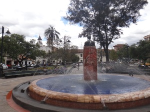 A fountain in a small park downtown